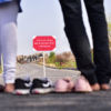 Boy and girl looking at a customized message board on road leaving footwear