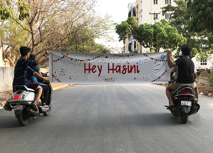Greeting banner surprise on road by bike riders