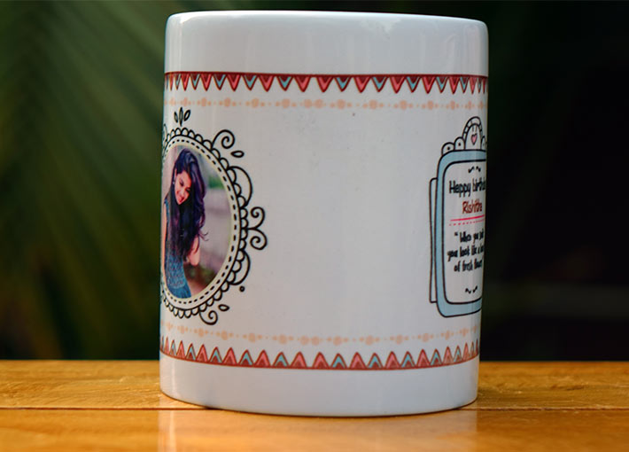 Picture and wishing notes printed in boho patterns on a white mug on a table.
